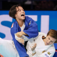 At 19 years old, two-time 52-kg world champion Uta Abe is hunting for her first Olympic medal alongside brother and 66-kg judoka Hifumi Abe. | KYODO