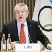 IOC President Thomas Bach speaks during a meeting in Lausanne, Switzerland, on Wednesday. | KYODO