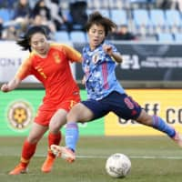 Mana Iwabuchi's hat trick propels Japan past China