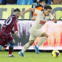Galatasaray defender Yuto Nagatomo moves the ball during a match against  Trabzonspor on Sunday in Trabzon, Turkey. | KYODO
