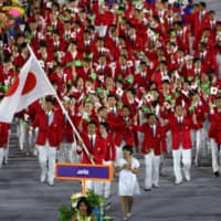 The Japanese team marches in the Parade of Nations during the opening ceremony for the 2016 Summer Olympics in Rio de Janeiro on Aug. 5, 2016. Japan will march last as the host nation during the 2020 opening ceremony in Tokyo. | KYODO