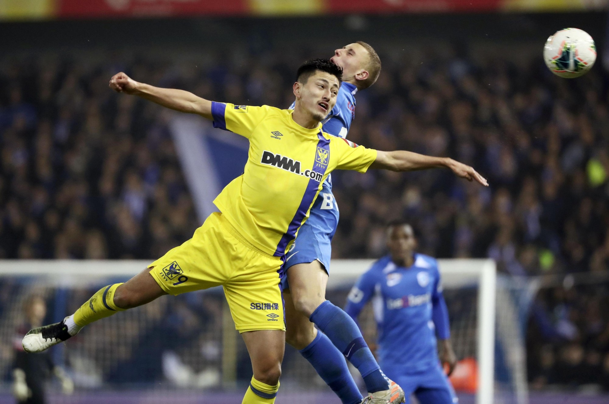 Sint-Truiden's Yuma Suzuki contends for the ball against a Genk player on Saturday in Genk, Belgium. | KYODO