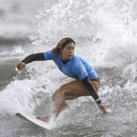 Surfer Amuro Tsuzuki is seen in a May file photo in Miyazaki Prefecture. | KYODO