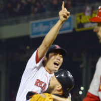 Red Sox reliever Koji Uehara celebrates after recording the final out against the Cardinals in Game 6 of the 2013 World Series, which clinched the title for Boston. | KYODO