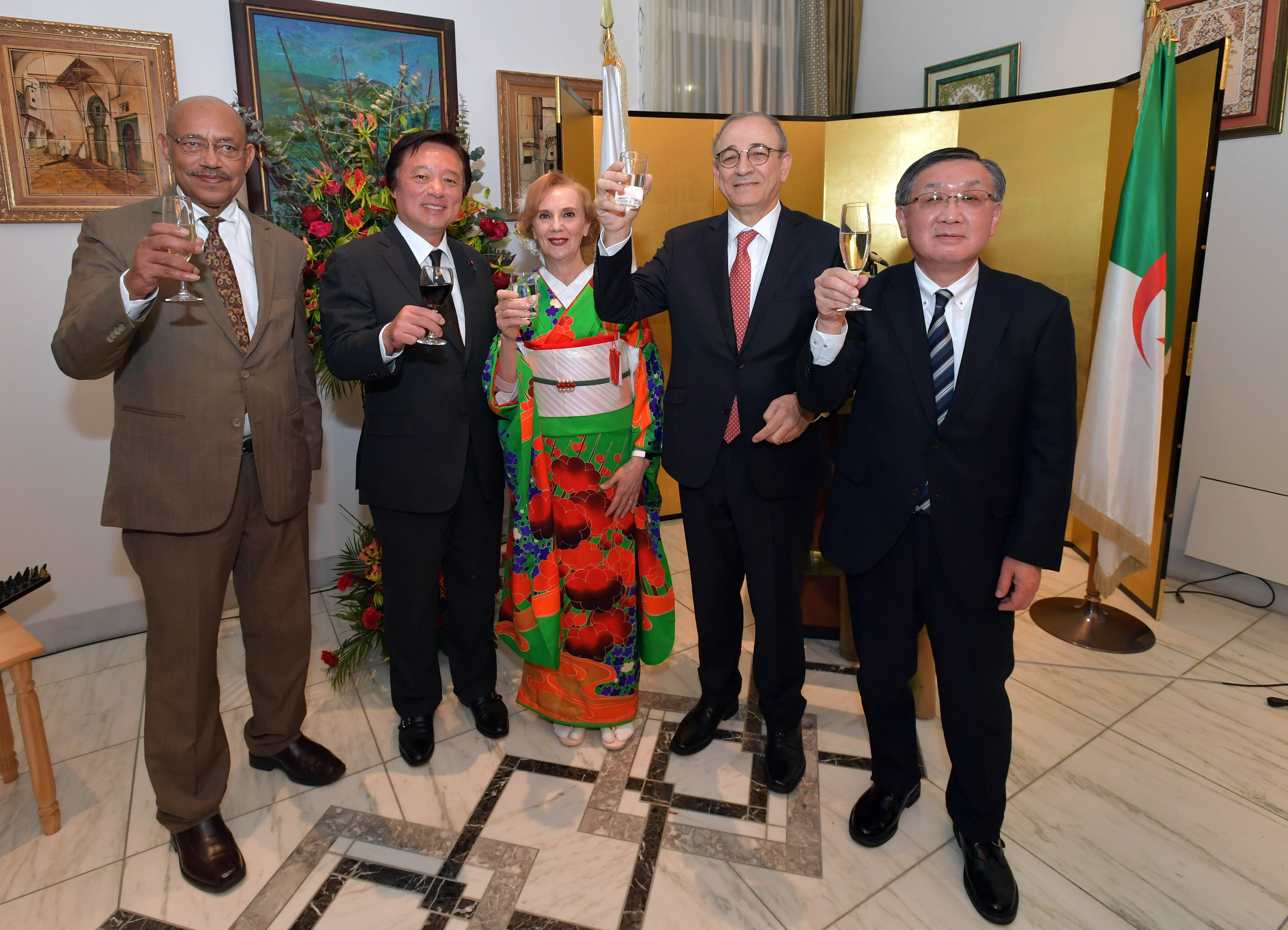 Ambassador of Algeria Mohamed El Amine Bencherif (second from right) and his wife, Amira (center) raise a toast with, from left, Ambassador of Eritrea and Dean of the African Diplomatic Corps Estifanos Afeworki Haile; State Minister for Foreign Affairs Kenji Wakamiya; and Masayuki Sato, representative director, chairman and chief executive officer of JGC Holdings Corporation and chairman of the Japan-Algeria Economic Committee of Keidanren, during a reception to celebrate Algeria's national day at the ambassador's residence in Tokyo on Dec. 20. | YOSHIAKI MIURA