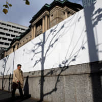 Citing slowing production due to weak demand from overseas, the Bank of Japan has downgraded its economic assessments of three out of the country's nine regions. | REUTERS