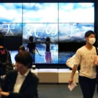 Director Makoto Shinkai's blockbuster 'Weathering With You' led the Japan box office in total revenue last year, raking in over ¥14 billion. | KYODO