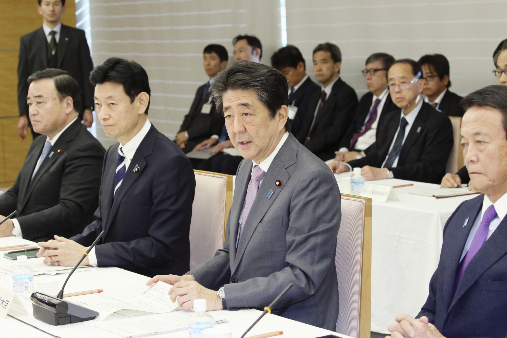 Prime Minister Shinzo Abe attends a meeting of the Council on Economic and Fiscal Policy last month at the Prime Minister's Office in Tokyo. | KYODO