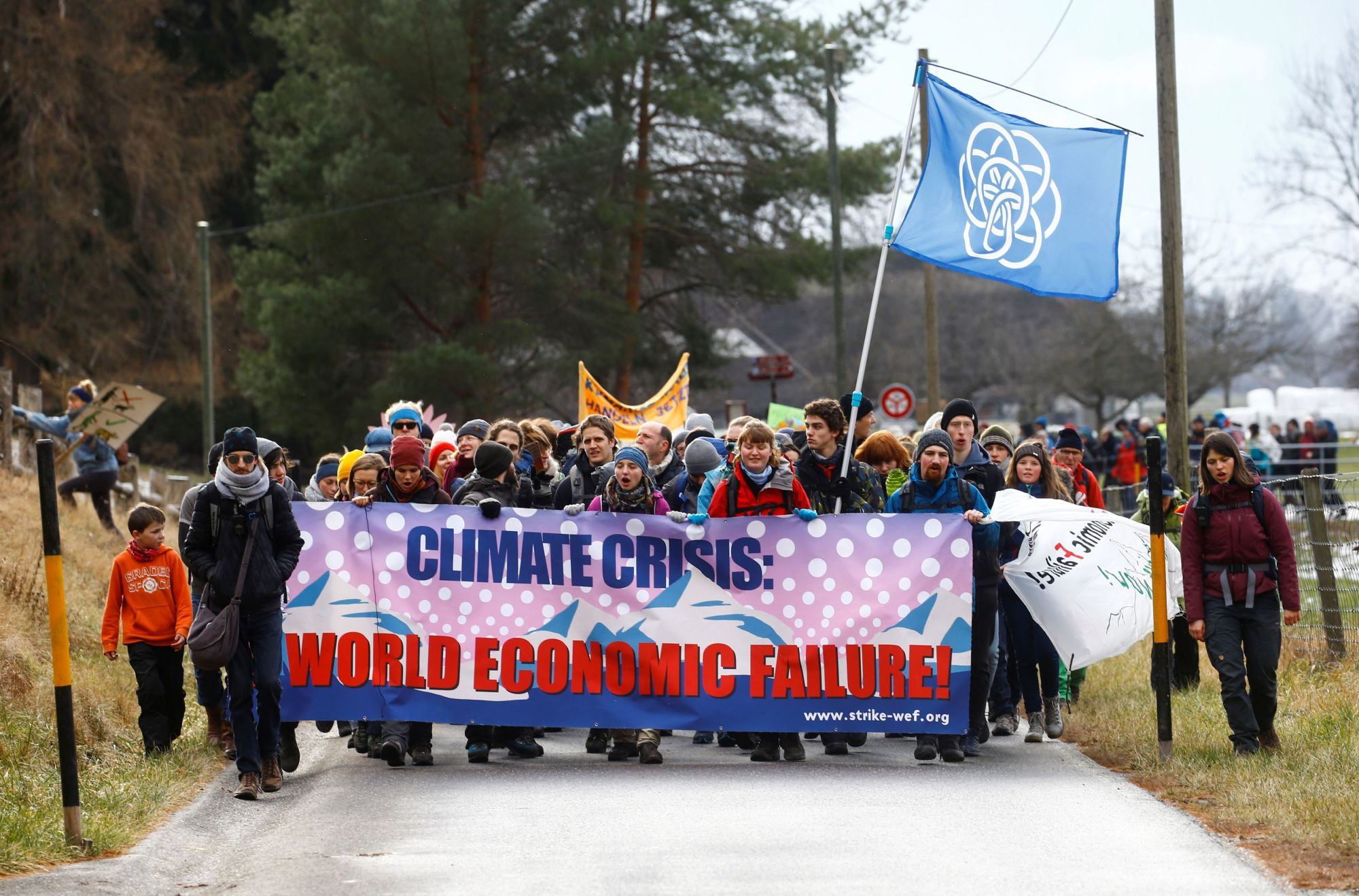 Climate activists start a 30-km hike to the Alpine resort of Klosters, to highlight issues surrounding climate change at the World Economic Forum Davos (WEF), in Landquart, Switzerland, Sunday. | REUTERS