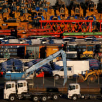 Newly manufactured vehicles await export at a port in Yokohama in 2017. Figures released Thursday showed that Japan logged a goods trade deficit of ¥1.64 trillion in 2019, marking the second straight year of red ink amid slowing demand in China. | REUTERS