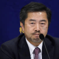 Nobuo Gohara, a lawyer and former prosecutor, listens during a news conference at the Foreign Correspondents' Club of Japan in Tokyo on Wednesday. He claims that former Nissan Motor chief Carlos Ghosn told him Nissan would go bankrupt in two or three years.   BLOOMBERG