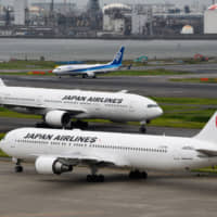 A decade after Japan Airlines' went bankrupt, criticisms over the government bailout remain