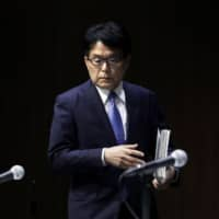 Hiroya Masuda, president and chief executive officer of Japan Post Holdings Co., arrives for a news conference in Tokyo on Jan. 9. | BLOOMBERG