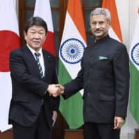 Foreign Minister Toshimitsu Motegi and Indian counterpart Subrahmanyam Jaishankar greet each other ahead of talks in New Delhi on Nov. 30. Japan and India have stepped up cooperation on digital infrastructure. | KYODO