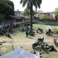 Motorbikes are seen parked within the premises of Gokada bike company in Lagos, Nigeria, last year. | REUTERS