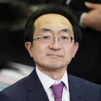 Iwao Nagashima, incoming president and chief executive officer of Mitsubishi UFJ Trust & Banking Corp., reacts at a news conference in Tokyo on Friday. Mitsubishi UFJ Financial Group Inc. has turned to a math expert to help Japan's biggest bank forge a path in the digital era. | BLOOMBERG