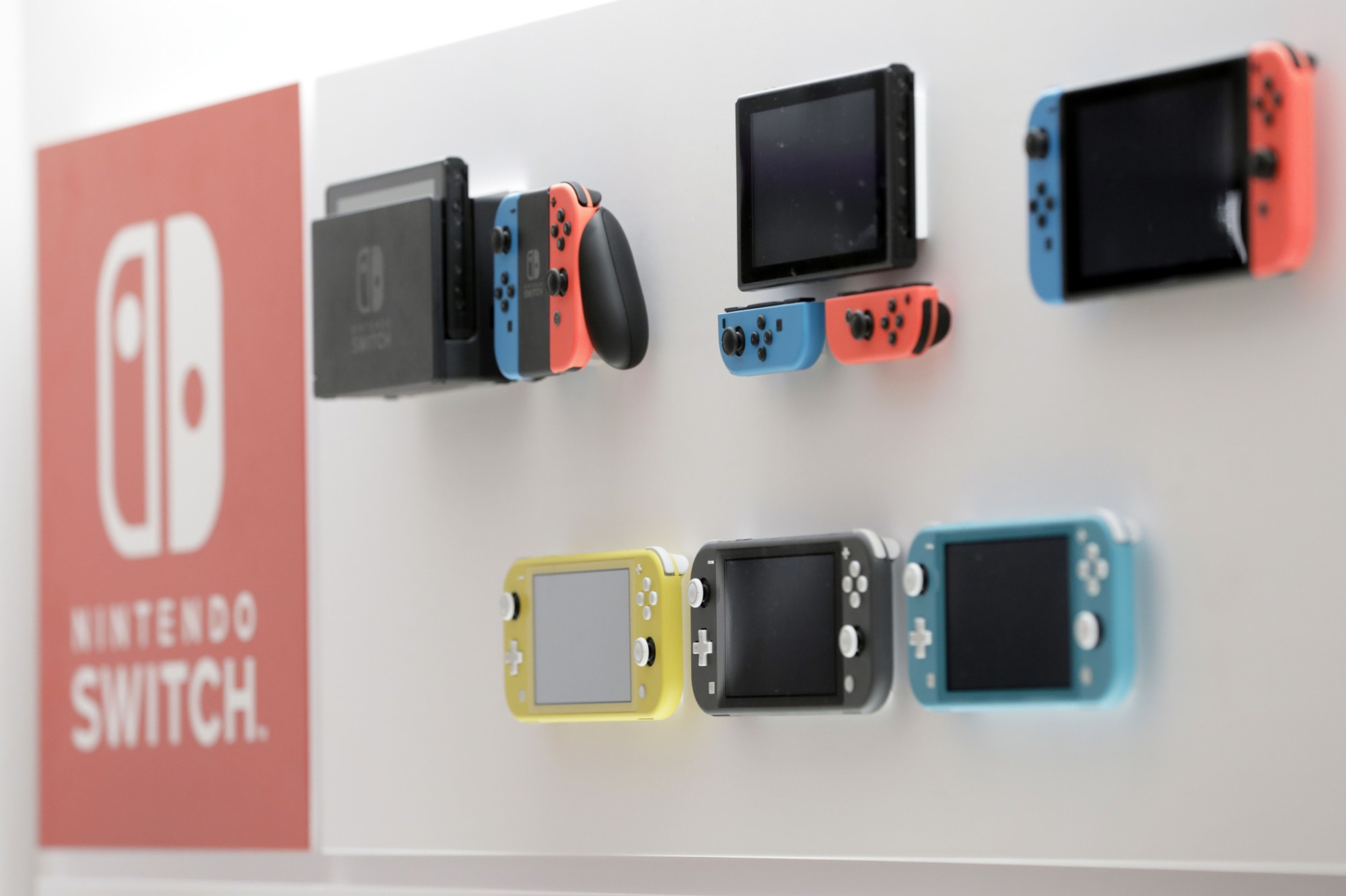 Nintendo Co. Switch and Switch Lite game consoles are displayed at the Nintendo Tokyo store in November.   BLOOMBERG