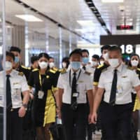 American Airlines pilots sue to block China flights as virus unnerves crews worldwide