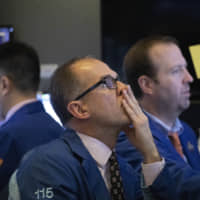 Wall Street starts 2020 at record levels on China stimulus and trade hopes