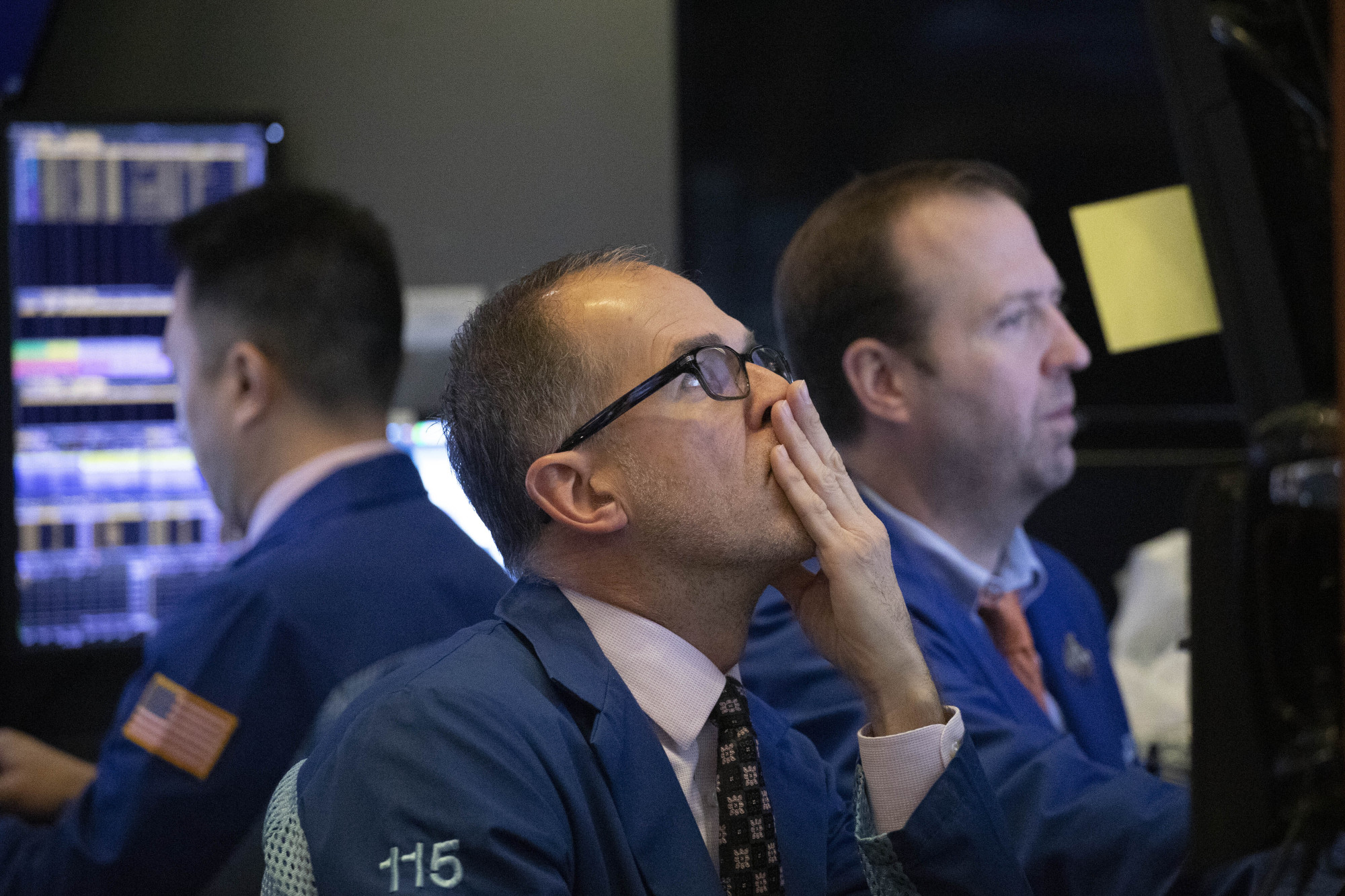 Traders monitor stock prices at the New York Stock Exchange Thursday. Global shares rose Thursday on optimism about a U.S.-China trade deal and the Chinese government's efforts to boost its economy. | AP