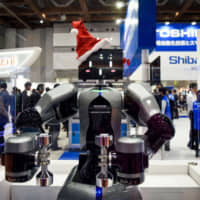 Toshiba Machine's humanoid robot is displayed at the International Robot Exhibition in Tokyo in December. | BLOOMBERG