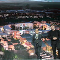 Toyota Motor Corp. chief Akio Toyoda and Danish architect Bjarke Ingels reveal plans to build a prototype 'city of the future' on a 710,000-square-meter site at the base of Mount Fuji in Shizuoka Prefecture during a news conference at the CES electronics trade show in Las Vegas on Monday. | AFP-JIJI