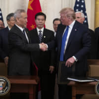 President Donald Trump and Chinese Vice Premier Liu He (left) shake hands after signing a U.S.-China trade agreement, in the East Room of the White House Wednesday in Washington. | AP