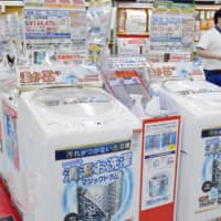 Last-minute demand for air conditioners and other major appliances before the consumption tax hike drove sales in 2019. | KYODO