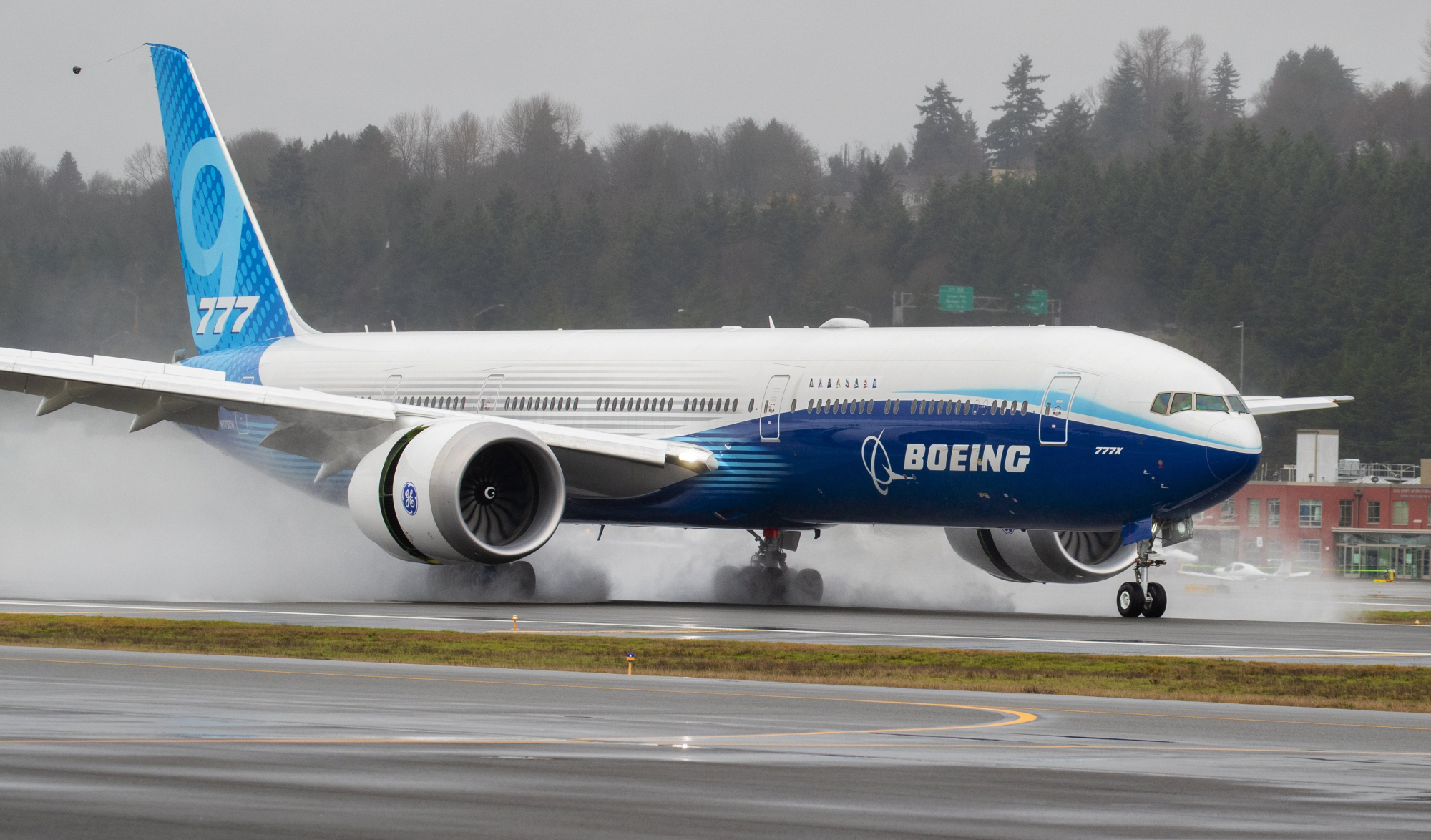 A Boeing 777X lands at Boeing Field in Seattle after its first flight on Saturday. | THE SEATTLE TIMES / VIA AP