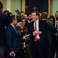 Sen. John Barrasso talks to media near the Senate floor during a brief recess from the day's Senate impeachment trial of President Donald Trump in Washington Wednesday. | REUTERS