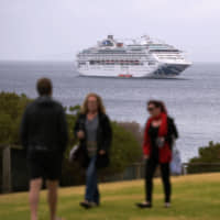 The first cruise ship to visit Kangaroo Island since fires destroyed an Australian national park there lies offshore on Sunday. | REUTERS