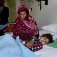 A girl who was injured in an avalanche is treated at a hospital in Muzaffarabad, the capital of Pakistan-administered Kashmir, Wednesday. Search teams aided by Pakistani troops pulled out 21 more bodies from homes destroyed by this week's avalanches in the disputed Himalayan region of Kashmir, raising the overall death toll due to severe winter weather to more than 155 for Pakistan and Afghanistan, officials said. | AP