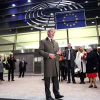 Britain's Brexit Party leader, Nigel Farage, leaves the European Parliament after a plenary session to vote on the Brexit deal in Brussels on Wednesday. | AFP-JIJI