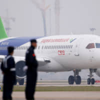 China's home-grown C919 passenger jet taxis after landing on its maiden flight at Pudong International Airport in Shanghai on May 5, 2017.  Delays in achieving final approval for the plane mean it will probably miss the current boom in jet orders and languish for years to come. | REUTERS