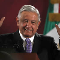 Mexican President Andres Manuel Lopez Obrador smiles during his daily morning news conference at the National Palace in Mexico City in November. The president closed out 2019 with a Tuesday video message in which he recounted his administration's successes in its first year, including rooting out corruption, and highlighted its challenges, foremost surging violence. | AP