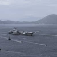 The Nanchang guided-missile destroyer, China's first 10,000-ton, class Type 055 destroyer, is expected to accompany aircraft carriers such as the Liaoning in battle groups. | BLOOMBERG