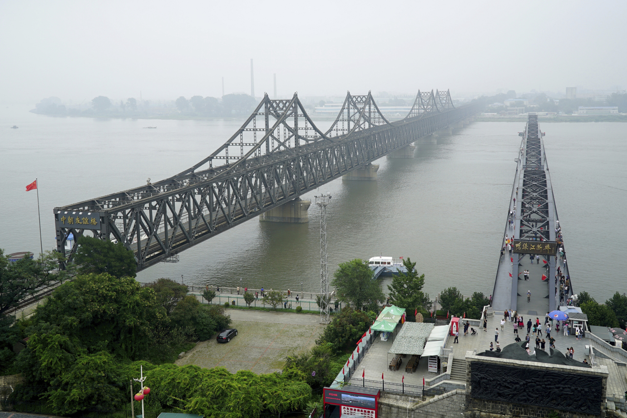 The Yalu River Broken Bridge (right) and the Friendship Bridge connecting China and North Korea in Dandong, in northeastern China's Liaoning province | AP