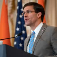 U.S. Defense Secretary Mark Esper participates in a press conference at the State Department in Washington Dec. 18. The Pentagon warned Thursday that the Iran-backed Kataeb Hezbollah group that stormed the U.S. Embassy in Baghdad would carry out more attacks on U.S. facilities — and would regret it. | AFP-JIJI