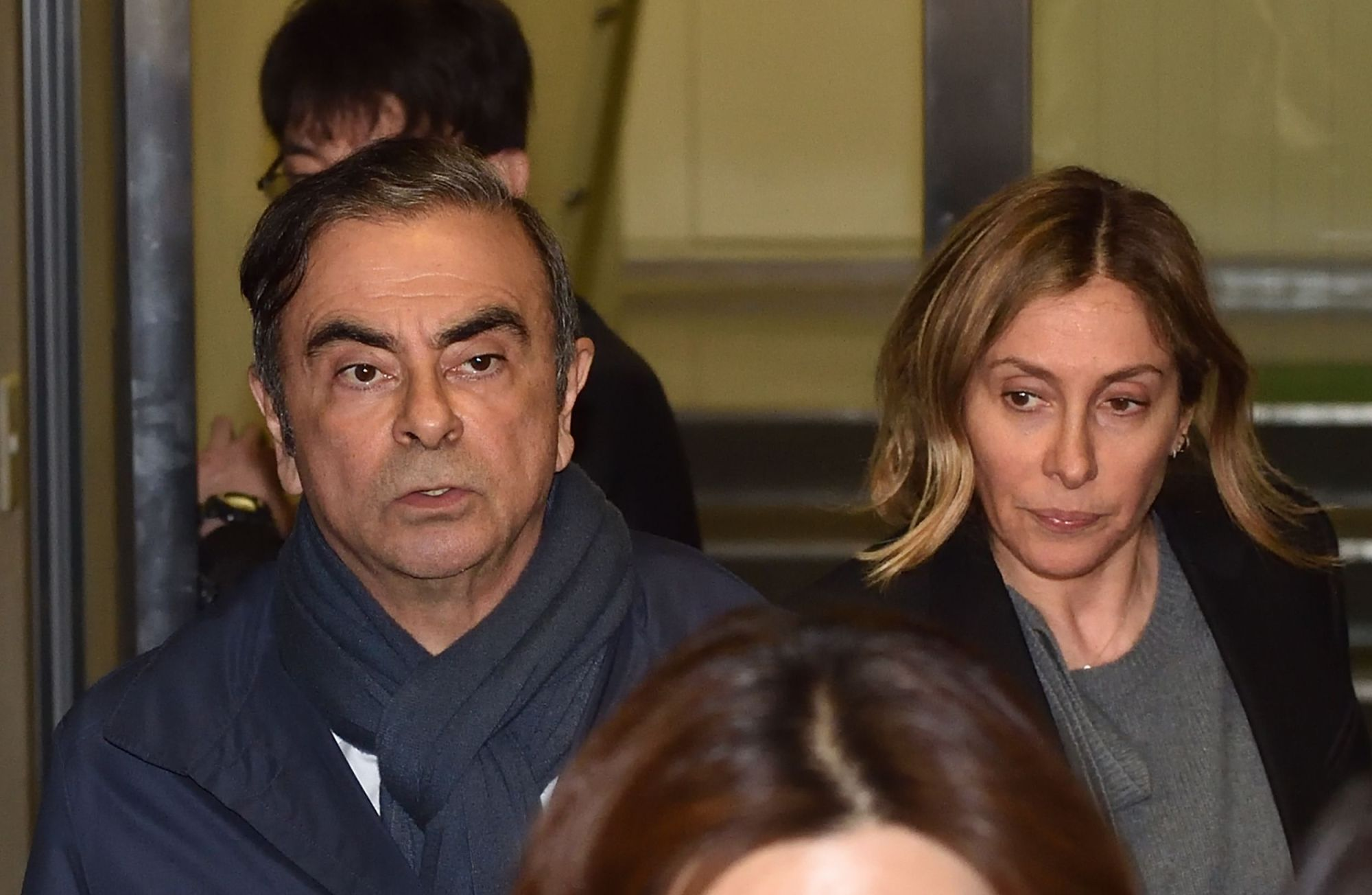 Former Nissan Chairman Carlos Ghosn and his wife, Carole, leave the office of his lawyer in Tokyo last April.   AFP-JIJI