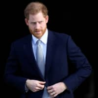 Britain's Prince Harry attends a rugby event at Buckingham Palace gardens in London Thursday.   REUTERS