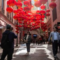 Lanterns for the coming Lunar New Year line a street in Hong Kong on Wednesday. | AFP-JIJI