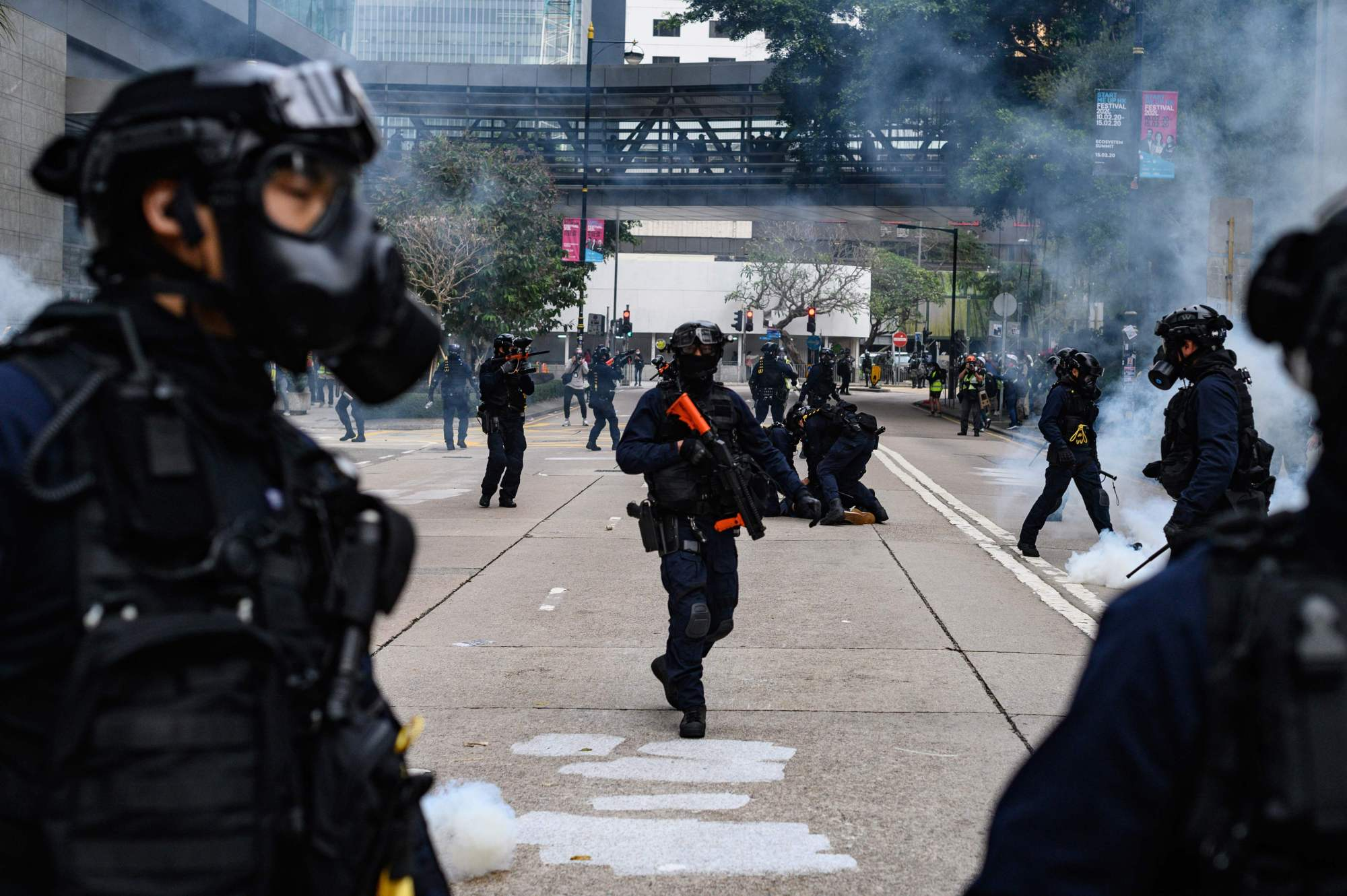 Police fire tear gas to disperse a crowd gathered for a rally at Chater Garden in Hong Kong on Sunday.   AFP-JIJI