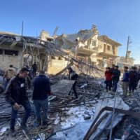 Syrians gather amid the rubble following regime airstrikes on a market in the town of Binnish in Syria's northwestern province of Idlib on Saturday.   AFP-JIJI