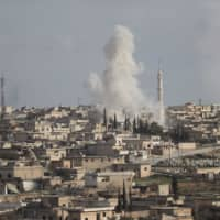 Smoke billows following a reported bombardment by Syrian regime forces on the town of Kafr Ruma on the outskirts of Maaret al-Numan, in the northwestern Syrian province of Idlib, on Monday. | OMAR HAJ KADOUR / VIA AFP-JIJI