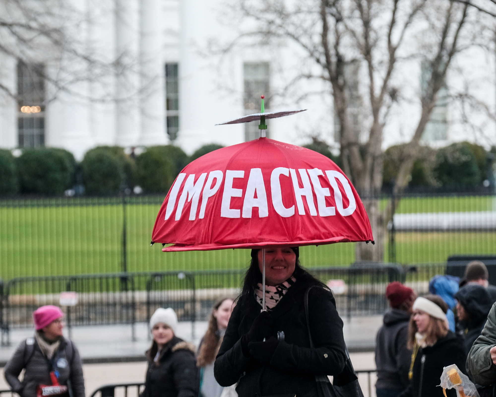 A demonstrator outside the White House following the Fourth Annual Women's March in Washington on Saturday   REUTERS