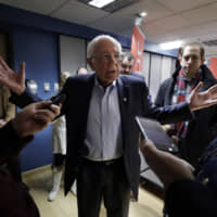 Democratic presidential candidate Sen. Bernie Sanders= speaks with reporters following a forum broadcast on radio in a New Hampshire Public Radio station, Sunday in Concord, New Hampshire.   AP