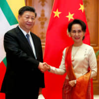 Myanmar and China agree to speed projects but ink no new deals