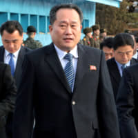 A North Korean delegation led by Ri Son Gwon, chairman of the Committee for the Peaceful Reunification of the Country, crosses the border for a meeting at the truce village of Panmunjom in the Demilitarized Zone separating the two Koreas on Jan. 9, 2018. | REUTERS