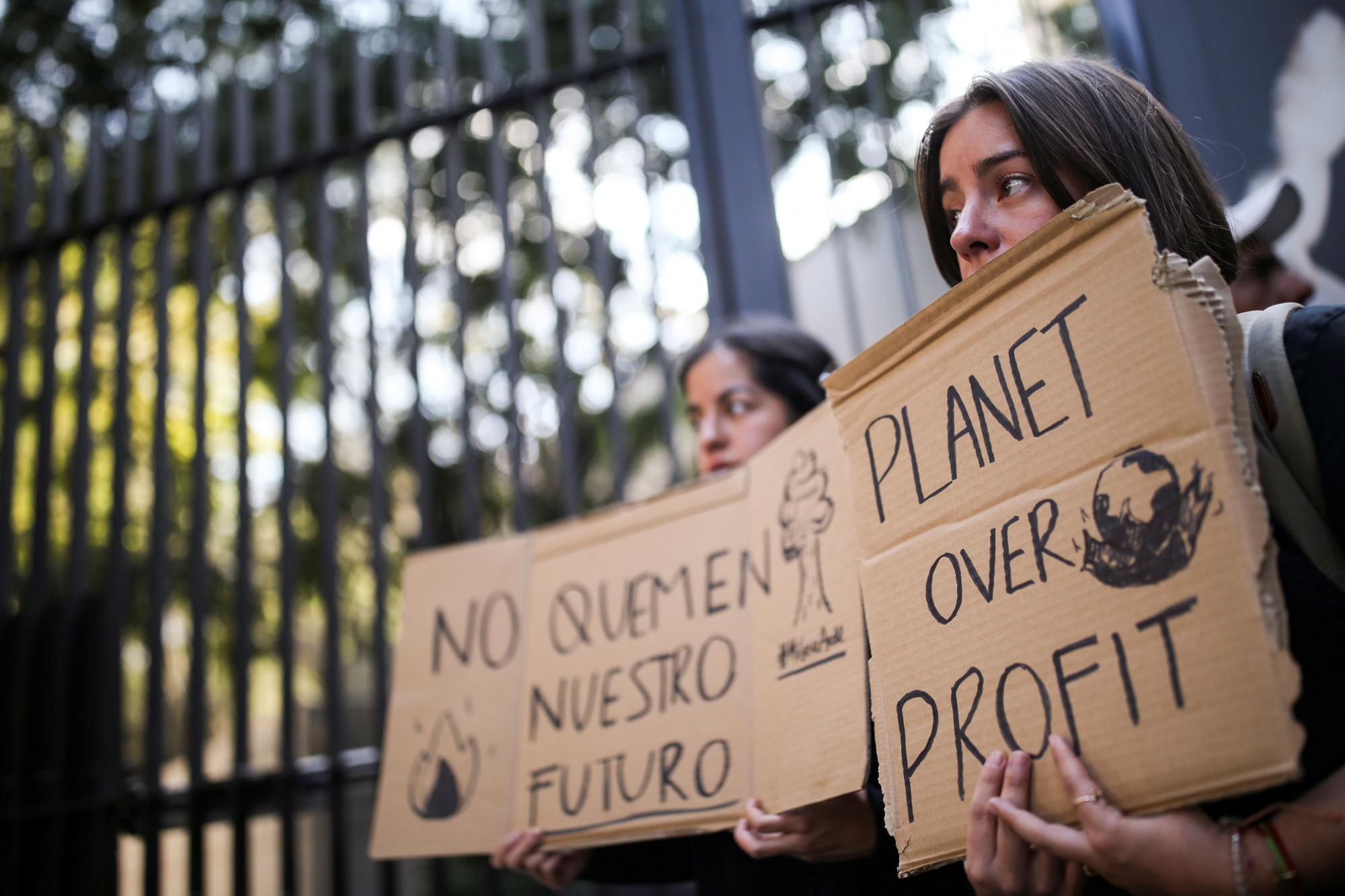 Activists hold signs in a protest over Australia's bush fire crisis, outside the Australian Embassy in Mexico City on Friday. | REUTERS