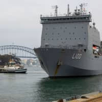 Australian navy races to rescue thousands as new wildfire threat looms